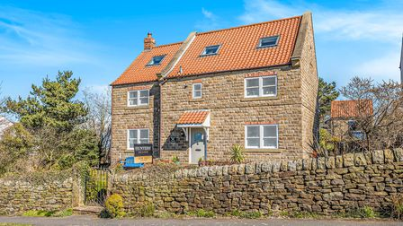 The pretty stone cottage is close to a small cluster of houses in Ravenscar