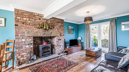 A hearty wood burner keeps the cottage cosy