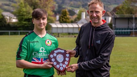Man of the match Chris Badlam receiving the Sam Marriott shield from former youth coach Jon Miller