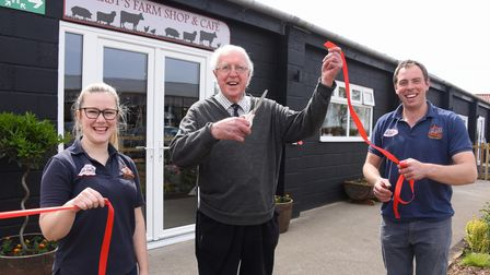 Robert and Becca Hirst celebrate as Robert's grandfather, John Hirst cuts the ribbon to open their n