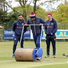 Attempts are made to dry the playing area after heavy rain fell ahead of Wanstead and Snaresbrook CC