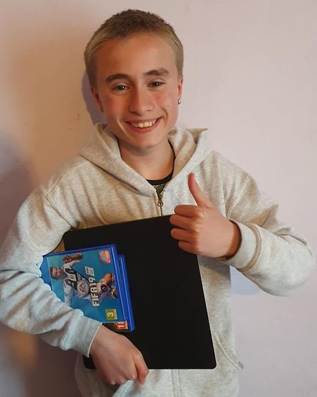 AJ Williams with his new PlayStation 4.