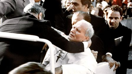 Bodyguards hold Pope John Paul II (C) after he was shot 13 May 1981 on Saint Peter's square by a Turkish extremist