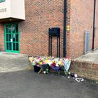 Friends and resident lay flowers where Daniel Laskos, 16, died in Church Road