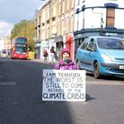 """Hackney resident and climate """"sitter"""" Precious Martini-Brown reveals her fears for the planet's future and blocks traffic."""