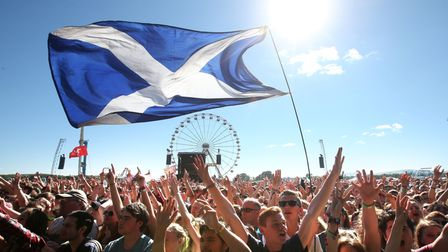 Music fans with a Saltire Flag in Kinross, Scotland