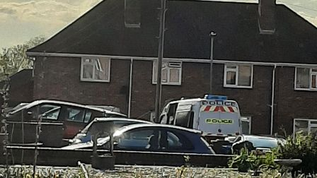 The police van at Hemlin Close in Earlham on Wednesday