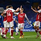 Arsenal's Emile Smith Rowe (left) celebrates scoring their first goal of the game with teammates dur