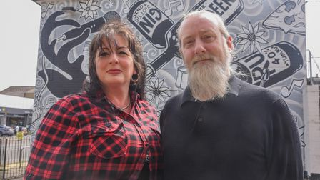 Louise Wilding, owner, and Rich Thurston, bar manager, by the mural that they had painted at The Rei