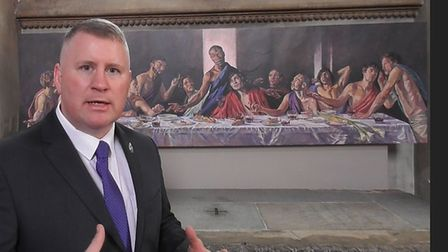 Far right activist Paul Golding in front of the black Jesus painting at St Albans Cathedral.