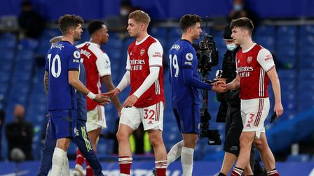 Arsenal's Emile Smith Rowe (32) shakes hands with Chelsea's Christian Pulisic (left) after the Premi