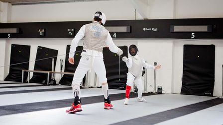 Richard Kruse takes on a young ZFW fencer, Ben Turner, at the Leon Paul Fencing Centre in Hendon