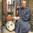 fr luc emmerich with broken statue