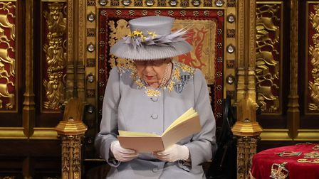 Queen Elizabeth II delivers a speech from the throne in House of Lords at the Palace of Westminster.