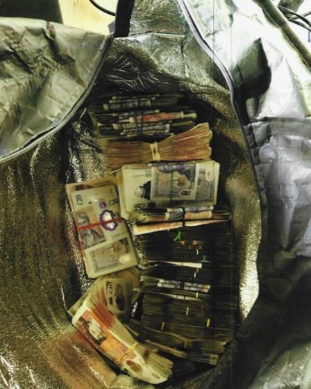 Cash seized from the home of Shabaz Khan in Lime Grove, Barkingside. In total£91,520 was seized from this address.