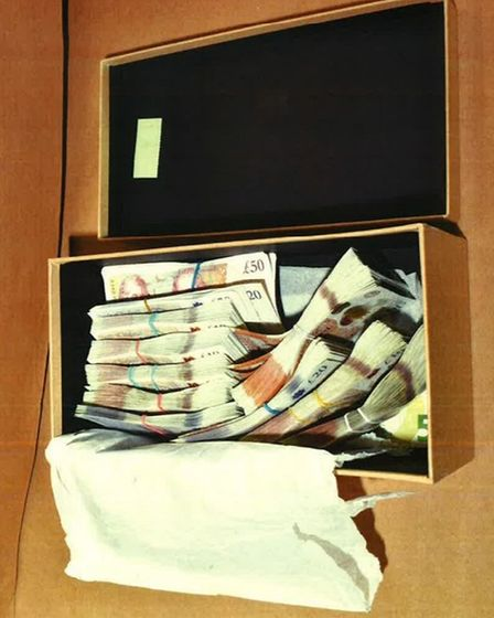 A box of cash seized from the home ofIoan Gherghel in Stratford. Intotal£11,385 was seized from this address.