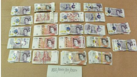 Cash seized from the home ofMoshin Khan, Shazad Khan and Maria Shah in Babbacombe Gardens, Redbridge.