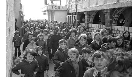 Youngsters rushing in to the Free Rides Day at Mannings Amusement Park, Felixstowe in April 1973