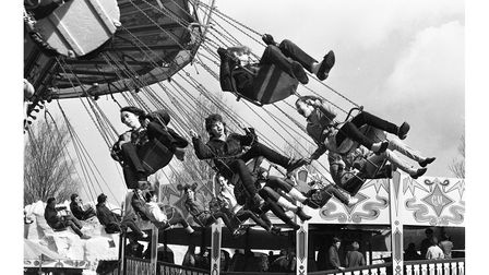 Children enjoying the swings ride at Mannings Free Rides Day in 1983
