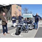 Chairman of East Suffolk Council, Keith Robinson, withthe Wish List Bikers after they receivedfunding.