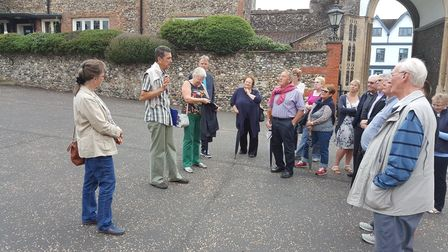 City of Norwich tourist guide Roger Smith out in force with a group of visitors