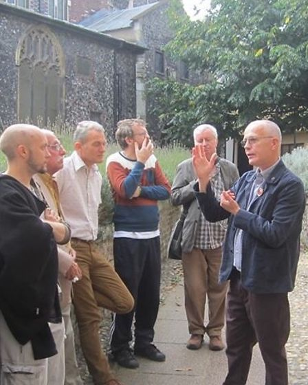 City of Norwich tourist guide Christopher Moore (right) gives a walking tour of the city