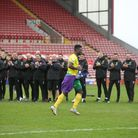 Backroom staff and players applaud and cheer Alex Tettey of Norwich at Barnsley