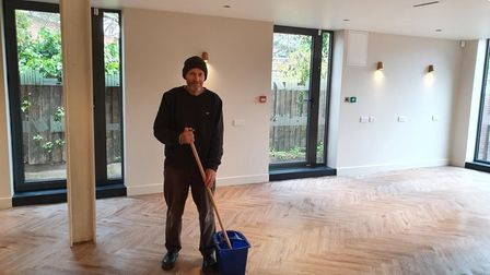 Cricklewood Library volunteer Joe Keating getting the hall ready for activities starting