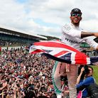 Lewis Hamilton celebrates his victory with the crowd after winning the 2016 British Grand Prix at Si