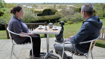 Two people having a cup of tea overlooking How Hill