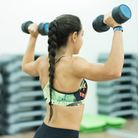 People doing bodypump and isometric exercises at gym