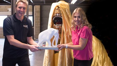 Peter Marron and Ellie Edge from Break with a T. rex and mammoth model.