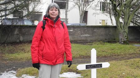 Maureen Spinks next to the grave of her great-uncle, Great Yarmouth man Henry Coe, who was buried in Iceland in 1926.