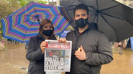 Amir Benghrbi is pictured right during the protest outside the Forum in Norwich