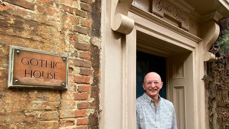 Clive Harvey, 71, pictured outside his Gothic House B&B just off Magdalen Street