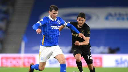Brighton and Hove Albion's Pascal Gross (left) and West Ham United's Pablo Fornals battle for the ba