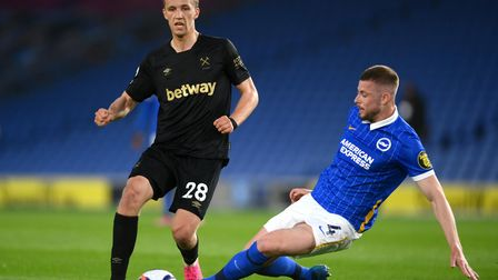 Brighton and Hove Albion's Adam Webster (right) tackles West Ham United's Tomas Soucek during the Pr