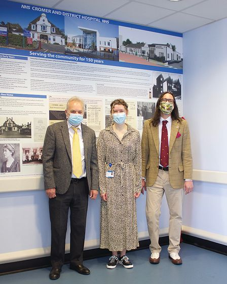 Bruce Stratton, Alex Hannah and Matthew Kelling in front of the new history wall at Cromer Hospital.