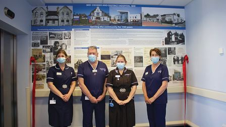 Nurses at Cromer Hospital in front of the new history wall.
