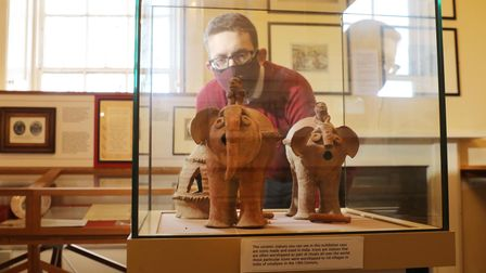 Museum curator Owen Gower with Shitala Mata, the goddess of smallpox, riding elephants made in late