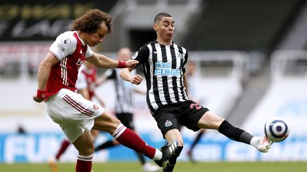 Arsenal's David Luiz (left) and Newcastle United's Miguel Almiron battle for the ball during the Pre