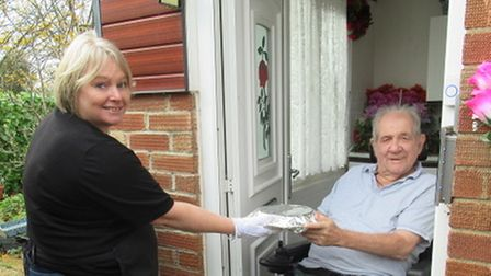 Helen Mountain delivering a meal to Brian Francis