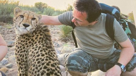 Colin Howard pictured at a cheetah rehabilitation centre for his wife's 40th birthday 10-years-ago