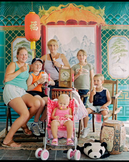 A group photograph of women and children on holiday