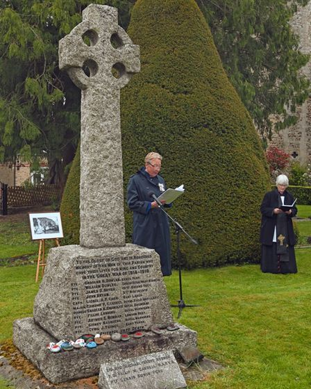 The service at the Great Paxton War Memorial.