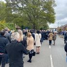 Mourners outside a church.