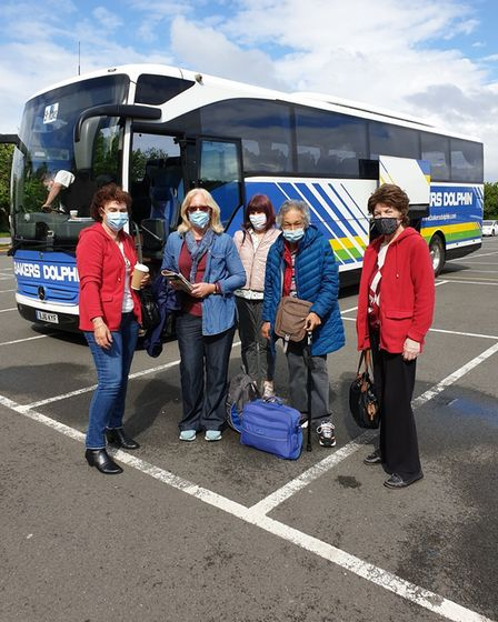 A group of travellers including Patricia Davies, far right, preparing to go to Cornwall.