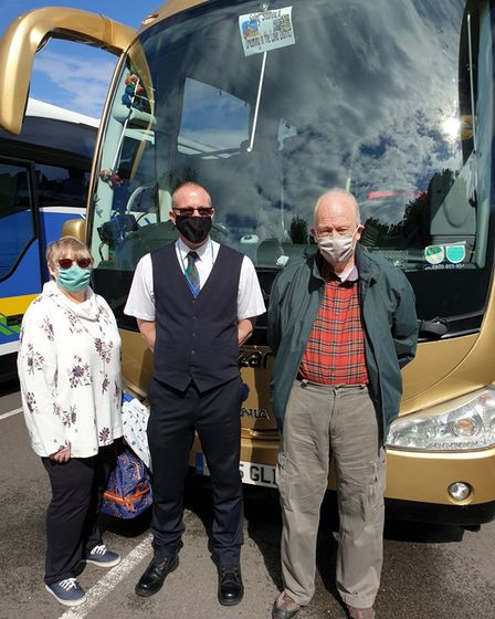 Driver Paul Mansfield with John and Katie Trowbridge, from Bristol.
