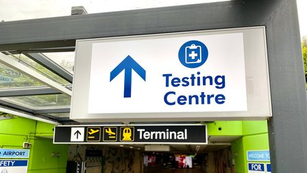 """A sign reads """"Testing Centre"""" with an arrow straight on"""