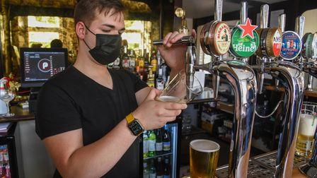 A staff member pulling some pints at The Red Lion in Norwich. Picture: Danielle Booden